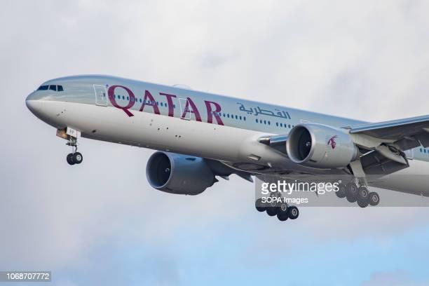 Qatar Airways Boeing 777300 seen landing at London Heathrow International Airport LHR / EGLL in London The aircraft is specifically a Boeing 7773DZ...