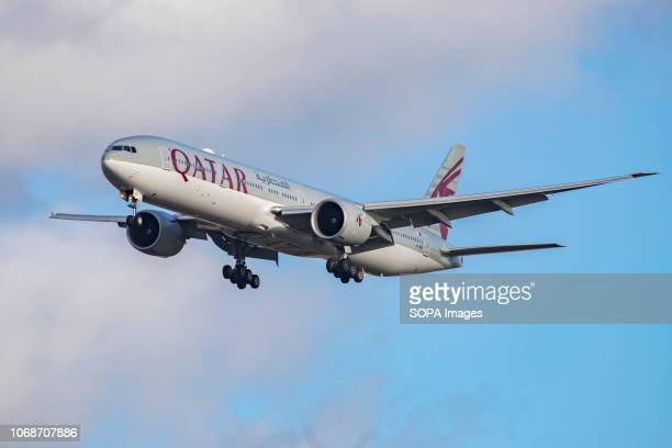 Qatar Airways Boeing 777-300 seen landing at London Heathrow International Airport LHR / EGLL in London. The aircraft is specifically a Boeing...
