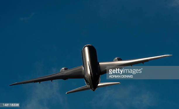 A Qatar Airways Boeing 787 Dreamliner takes part in a flying display during the second day at the Farnborough International Airshow in Hampshire...