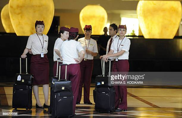 Qatar Airways cabin crew wait to check into a fivestar hotel in Sri Lanka's capital of Colombo on August 3 2009 Sri Lanka on August 3 announced plans...