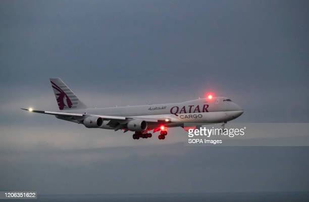 Qatar airways Cargo Boeing 747 aircraft lands at the Hong Kong International airport. Airlines across the globe have cancelled flights, postponed or...