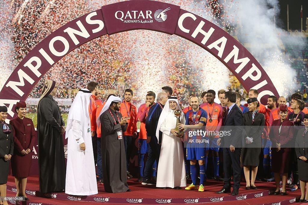 Qatar airways CEO Akbar Al Baker presenting the trophy to Andres Iniesta of Barcelona after winning the Qatar Airways Cup match between FC Barcelona and Al-Ahli Saudi FC on December 13, 2016 in Doha, Qatar.