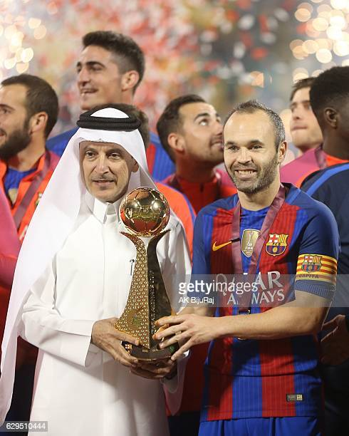 Qatar airways CEO Akbar Al Baker presenting the trophy to Andres Iniesta of Barcelona after winning the Qatar Airways Cup match between FC Barcelona...