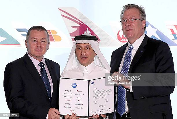 Qatar Airways chief executive Akbar alBaker International Consolidated Airlines Group SA chief executive officer Willie Walsh and Oneworld chief...