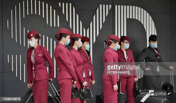Qatar Airways crew prepare to enter Sydney international airport to fly a repatriation flight back to France on April 2 amid the COVID-19 coronavirus...