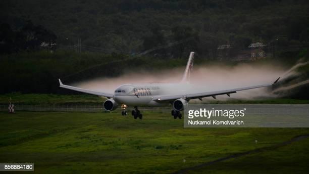Qatar airways landing at Phuket airport with vapor over wing
