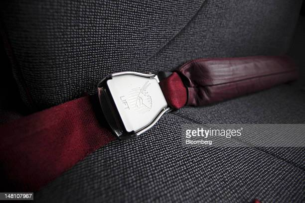A Qatar Airways logo sits on the seat belt clasp of business class seat inside a Boeing Co 787 Dreamliner aircraft on the first day of the...