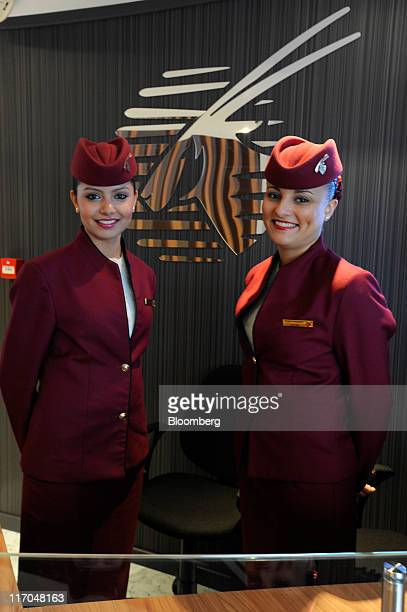 Qatar Airways Ltd flight attendants pose for a photograph at the Paris Air Show in Paris France on Monday June 20 2011 The 49th International Paris...