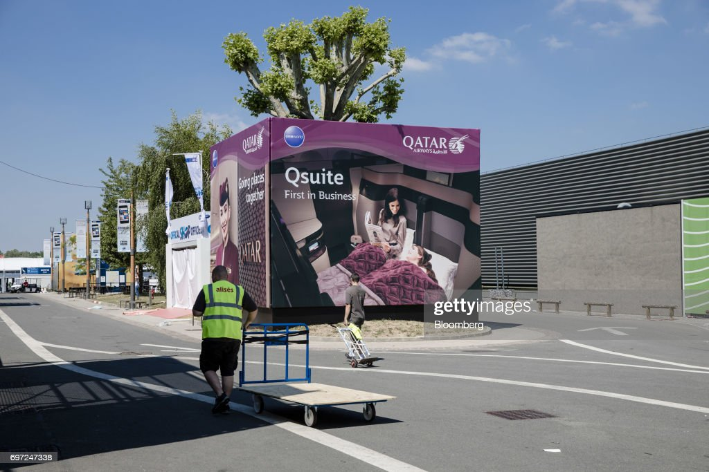 A Qatar Airways Ltd. hoarding displays Qsuite business class travel ahead of the 53rd International Paris Air Show at Le Bourget, in Paris, France, on Sunday, June 18, 2017. The show is the world's largest aviation and space industry exhibition and runs from June 19-25. Photographer: Marlene Awaad/Bloomberg via Getty Images