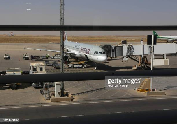 A Qatar airways plane is pictured on the tarmac at Arbil airport in the capital of Iraq's autonomous northern Kurdish region on September 28 2017 All...