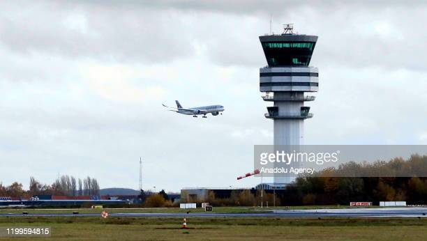 Qatar Airways plane is seen at Brussels Airport as storm 'Ciara' and its strong winds effect the activity at the airport, in Brussels, Belgium on...