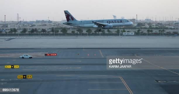 A Qatar Airways plane lands at the Hamad International Airport in the Qatari capital Doha on June 12 2017 Qatar Airways called on the UN's aviation...