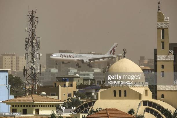 Qatar airways plane prepares to land at Khartoum International Airport in the Sudanese capital on March 31, 2019. - Its the last flight from Doha to...