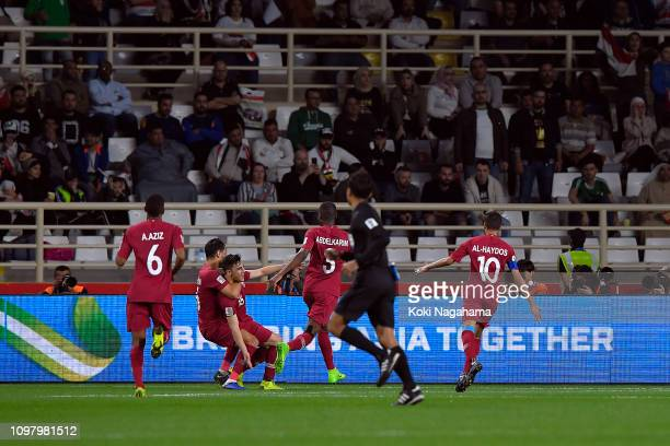 Qatar celebrate scoring their opening goal during the AFC Asian Cup round of 16 match between Qatar and Iraq at Al Nahyan Stadium on January 22 2019...