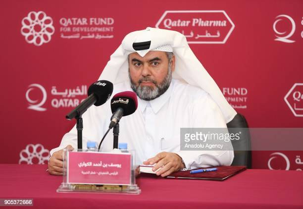 Qatar Charity CEO Yousef bin Ahmed Al Kuwari attends the signing ceremony with Qatar Pharma Chairperson Dr Ahmed bin Mohammed Al Sulaiti and General...