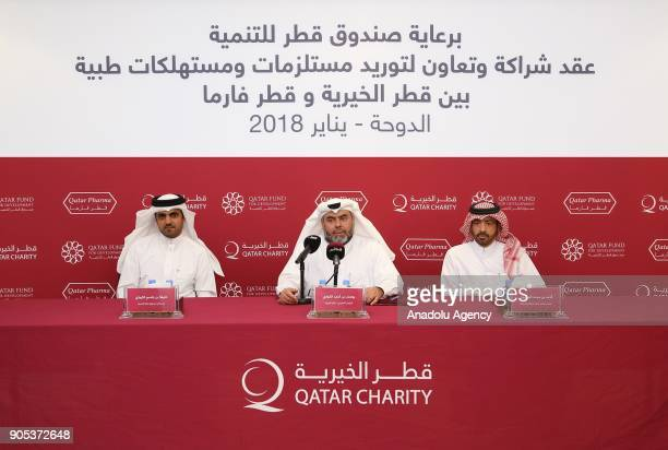 Qatar Charity CEO Yousef bin Ahmed Al Kuwari Qatar Pharma Chairperson Dr Ahmed bin Mohammed Al Sulaiti and General Manager of Qatar Fund For...