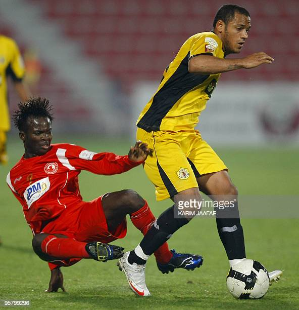 Qatar club's Brazilian midfielder Marcio Jose De Oliveira fights for the ball with AlArabi's player Muaaz Yousef during their Qatar Stars League...