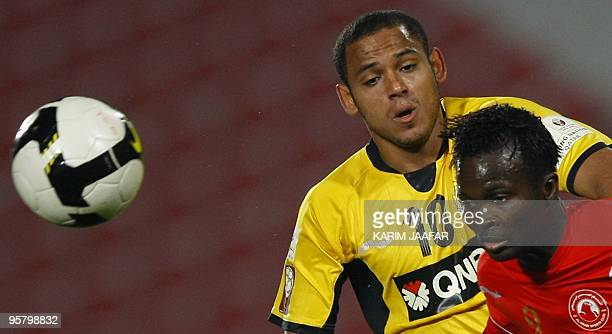 Qatar club's Brazilian midfielder Marcio Jose De Oliveira vies for the ball against AlArabi's Muaaz Yousef during their Qatar Stars League football...