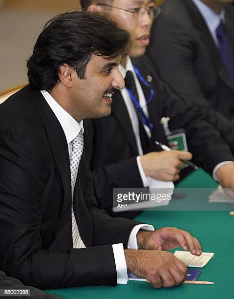Qatar Crown Prince Sheikh Tamim Bin Hamad Al Thani meets with Japanese Prime Minister Taro Aso at Aso's official residence in Tokyo on May 27 2009...