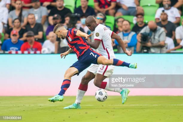 Qatar defender Abdelkarim Hassan attempts to maneuver past the defense of United States forward Paul Arriola during the Gold Cup semifinal match...