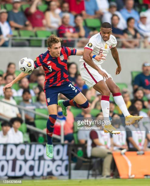 Qatar defender Pedro Miguel heads the ball away from United States defender Sam Vines during the Gold Cup semifinal match between the United States...