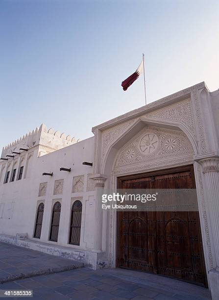 Qatar Doha Doha Fort Exterior view showing ornate doors with the Qatar flag flying above