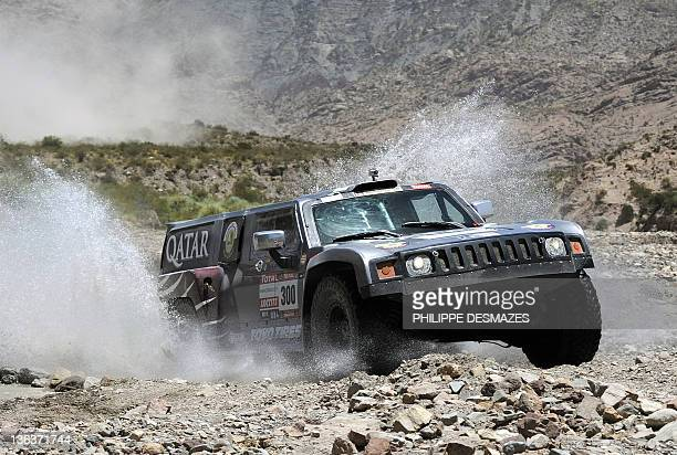 Qatar driver Nasser Al Alttiyah steers his Hummer during the Stage 3 of the 2012 Dakar Rally between San Rafael Mendoza province and San Juan San...