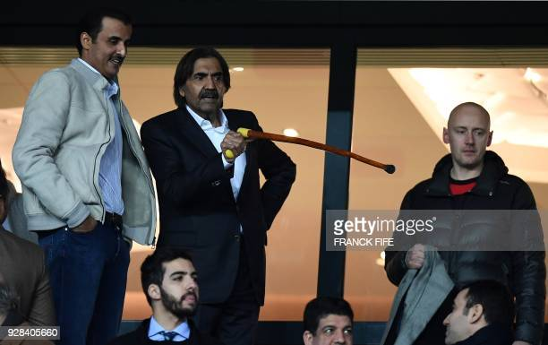 Qatar Emir Tamim Bin Hamad Al-Thani speaks with his predecessor Hamad ben Khalifa Al Thani as they arrive to attend the UEFA Champions League round...