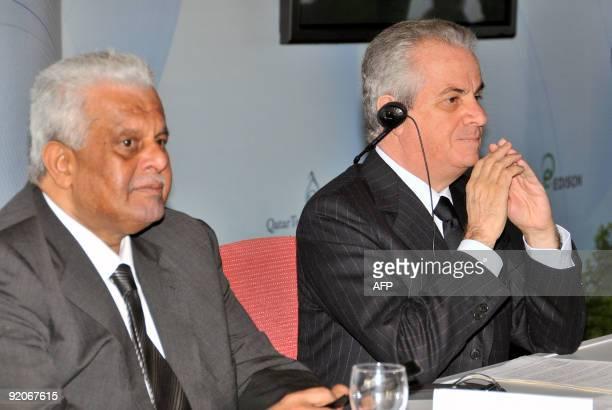 Qatar energy minister Abdullah bin Hamad AlAttiyah and Italian minister for economic development Claudio Scaiola pose on October 20 during a press...
