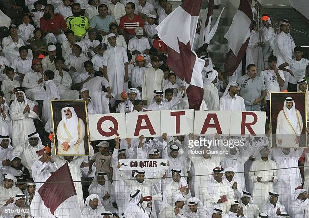 Qatar fans cheer during the 2010 FIFA World Cup qualifying match between Qatar and Australia at Jassim Bin Hamad Stadium on June 14 2008 in Doha Qatar