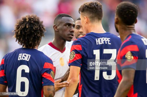 Qatar forward Al Moez Ali and United States forward Matthew Hoppe have words on the pitch during the Gold Cup semifinal match between the United...