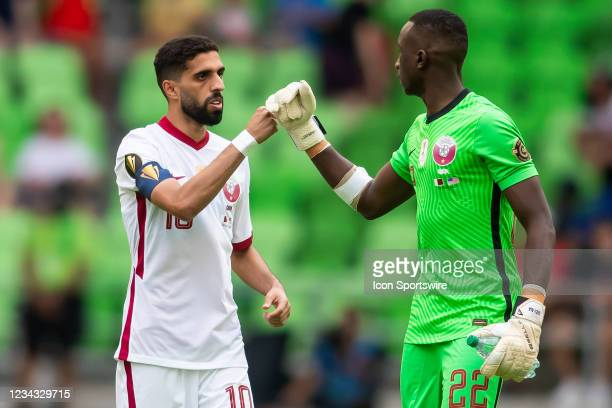 Qatar forward Hassan Al Haydos and Qatar goalkeeper Meshaal Barsham interact with each other during the Gold Cup semifinal match between the United...