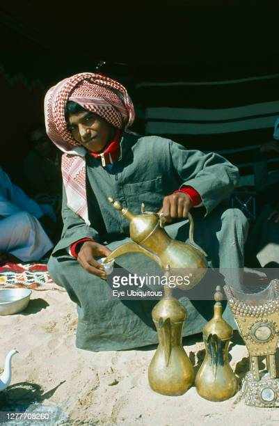Qatar, General, Bedouin youth pouring coffee.