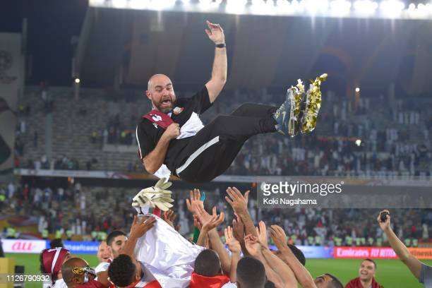 Qatar head coach Felix Sanchez Bas is tossed into the air by his players during the AFC Asian Cup final match between Japan and Qatar at Zayed Sports...