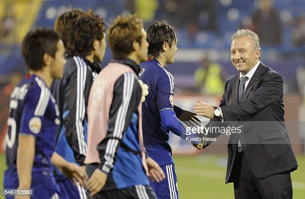 DOHA Qatar Japan coach Alberto Zaccheroni celebrates with his players after beating Qatar 32 in an Asian Cup quarterfinal match in Doha on Jan 21 2011