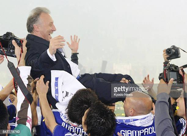DOHA Qatar Japan players toss coach Alberto Zaccheroni in the air after their team beat Australia 10 in the Asian Cup soccer final in Doha on Jan 29...