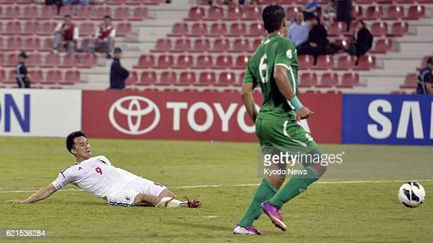 DOHA Qatar Japan's Shinji Okazaki scores past Iraq's Ali Adnan in the 89th minute of a World Cup soccer qualifier in Doha Qatar on June 11 2013 Japan...