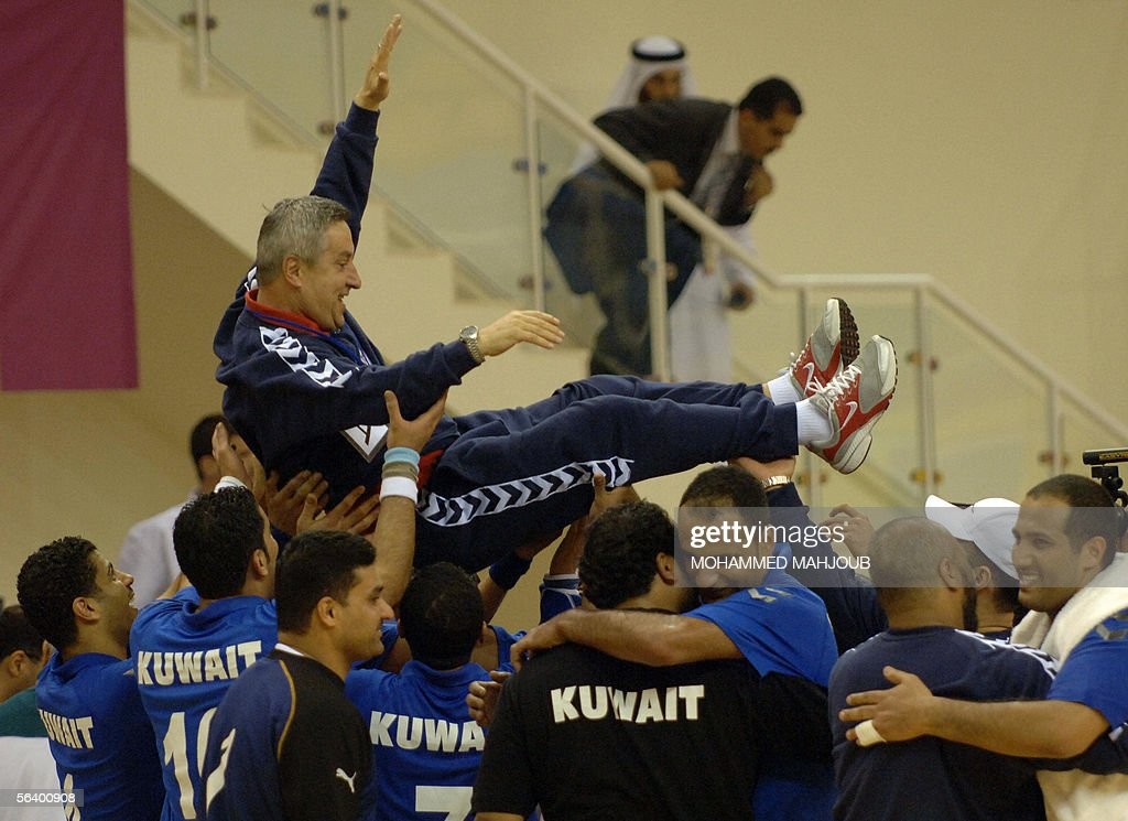 Kuwaiti handball players hoist their coa : News Photo