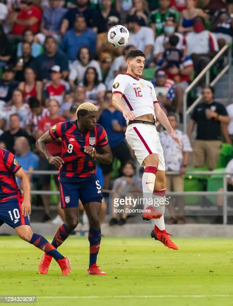Qatar midfielder Karim Boudiaf heads the ball away from United States forward Gyasi Zardes during the Gold Cup semifinal match between the United...
