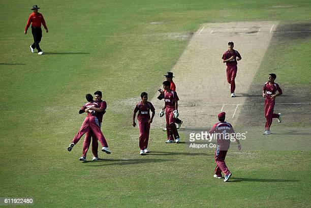Qatar players celebrate a wicket during the 2018 Under19 Cricket World Cup qualification Division 2 match between Saudi Arabia and Qatar at the...