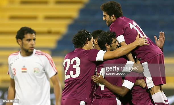 Qatar players celebrate after scoring a goal against Yemen during the two teams 2015 AFC Asian Cup group D qualifying football match in Doha on...