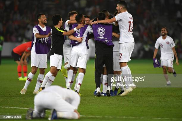 Qatar players celebrate to reach the final after beating South Korea during the AFC Asian Cup quarter final match between South Korea and Qatar at...