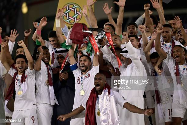 Qatar players celebrate with the Asian Cup after they defeated Japan 3-1 during the AFC Asian Cup final match between Japan and Qatar at Zayed Sports...