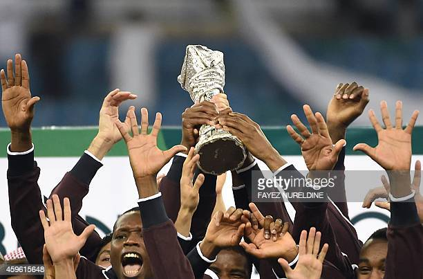 Qatar players celebrate with the Gulf cup trophy after defeating Saudi Arabia 2-1 in the final of the 22nd Gulf Cup football match at the King Fahad...