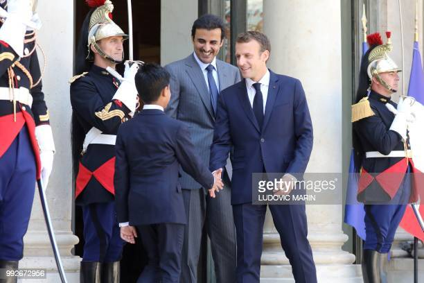 Qatar Sheikh Tamim bin Hamad Al Thani introduces his son Hamad to French president Emmanuel Macron upon arrival at the Elysee palace on July 6 in...