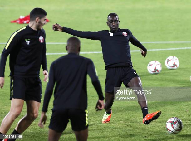 Qatar striker Almoez Ali and midfielder Karim Boudiaf take part in training in Abu Dhabi on Jan 31 a day before the Asian Cup football final against...