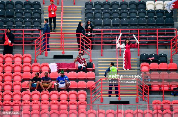 Qatar supporters cheer ahead of the 2019 AFC Asian Cup semifinal football match between Qatar and UAE at the Mohammed Bin Zayed Stadium in Abu Dhabi...