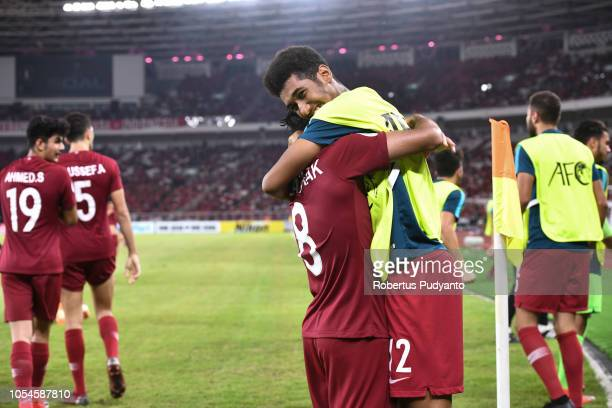 Qatar team celebrate victory after beating Thailand 73 during the AFC U19 Championship Indonesia quarter final match between Qatar and Thailand at...