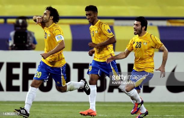 Qatari Al-Gharafa's Osman al-Assas celebrates with teammates after scoring a goal against UAE's Al-Shabab al-Arabi during their AFC Champions League...