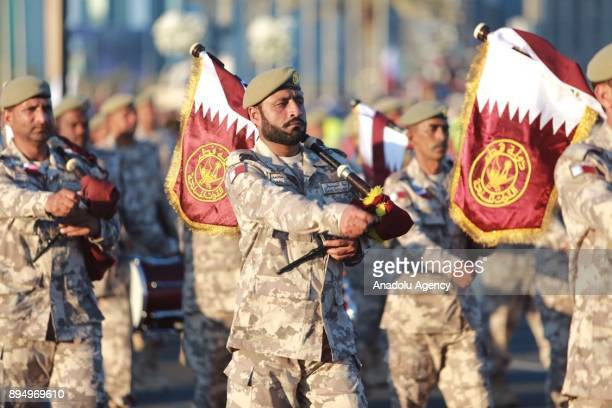 Qatari Armed Forces march during a military parade to commemorate the 139th anniversary of Qatar National Day in Doha Qatar on December 18 2017